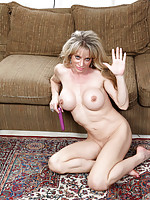 Sexy mom next door fucks her pussy with purple dildo